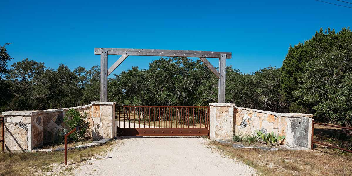 old-iron-gate-under-wood-entry-t